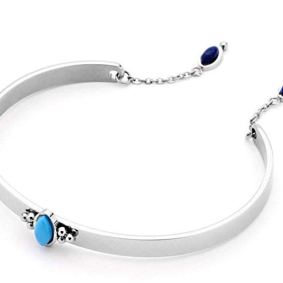 PASTICHE CLOUDY COVE POLISHED STAINLESS STEEL BANGLE, LAPIS & HOWLITE
