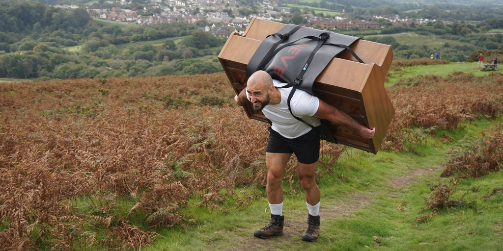 Max Glover Carries Piano up Mountain for Charity
