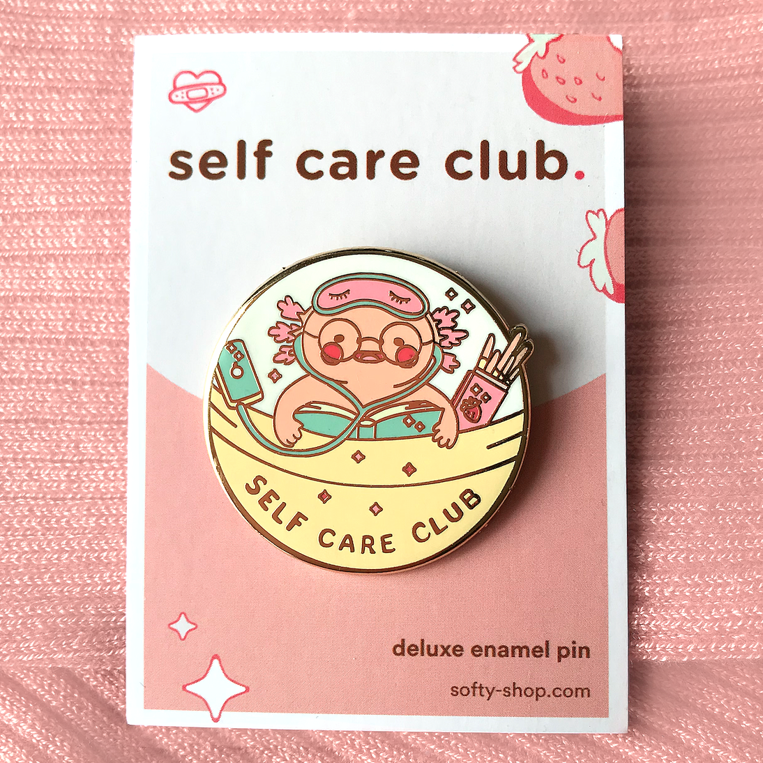 """self care club"" pin product shot"