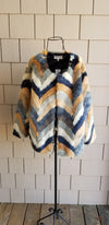 chevron pattern light orange camel teal and dark blue colored faux fur jacket for online boutique