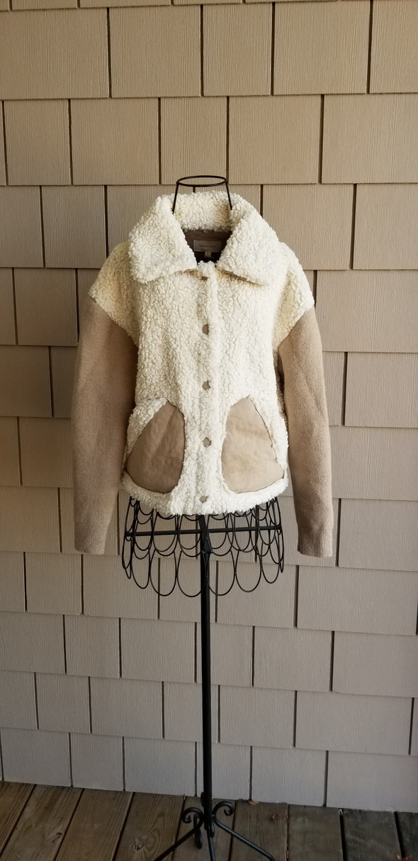 cream and beige Sherpa jacket with Saude sleeves and a Sherpa collar for online boutique