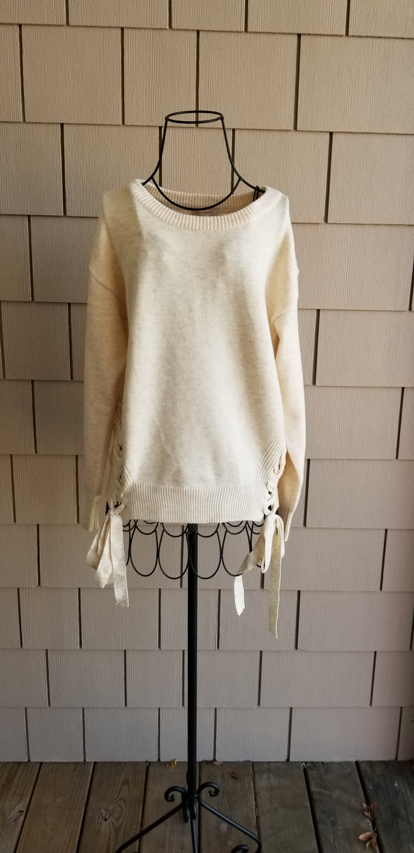 Creamy soft beige Soft Knitted Sweater with Side Braided Detailing for online boutique