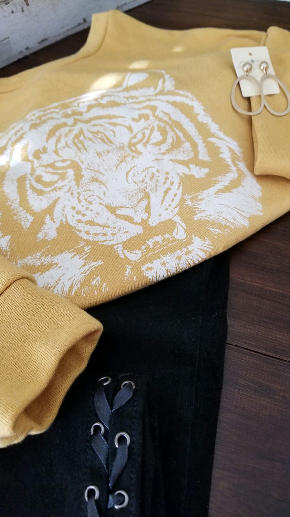 mustard yellow pullover with white tiger face on front for online boutique
