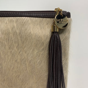 COWHIDE STATEMENT CLUTCH - CHAMPAGNE.`