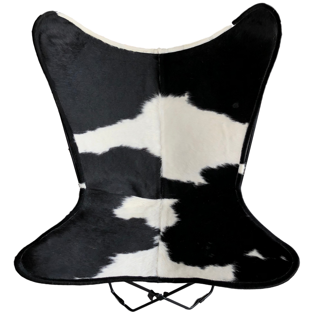 | BRUNO | - WHITE + BLACK COWHIDE BUTTERFLY CHAIR.