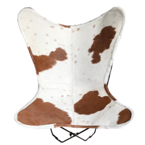 | SHELDON | - BROWN + WHITE COWHIDE BUTTERFLY CHAIR.