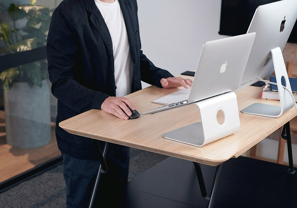 Black | man using laptop on standing desk
