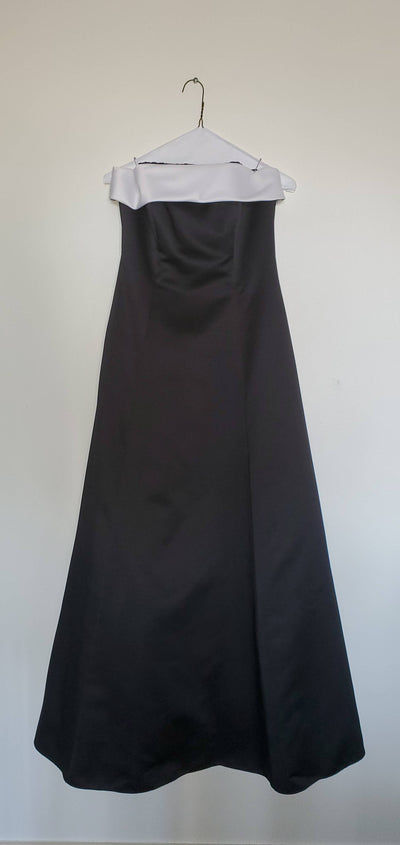 Gorgeous black dress with topped with white trim