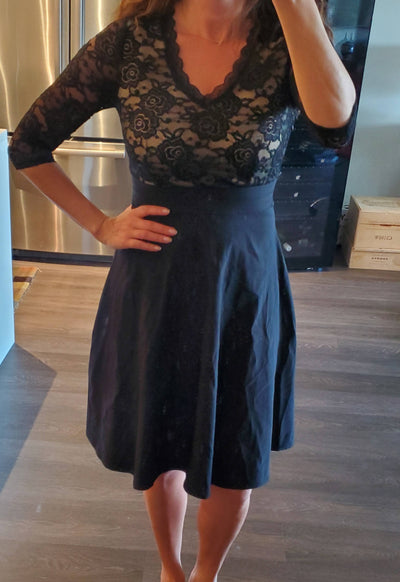 Black, knee-length dress with lacy top
