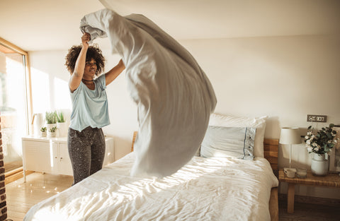 Photo of woman making a bed