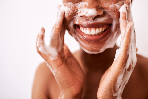 Photo of woman washing face and smiling