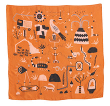 Load image into Gallery viewer, El Sueño Silk Scarf. Orange base colour with pink and navy printed imagery. Imagery depicts animals and ruins with a volcanic landscape.