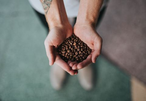 Coffee beans held in cupped hands