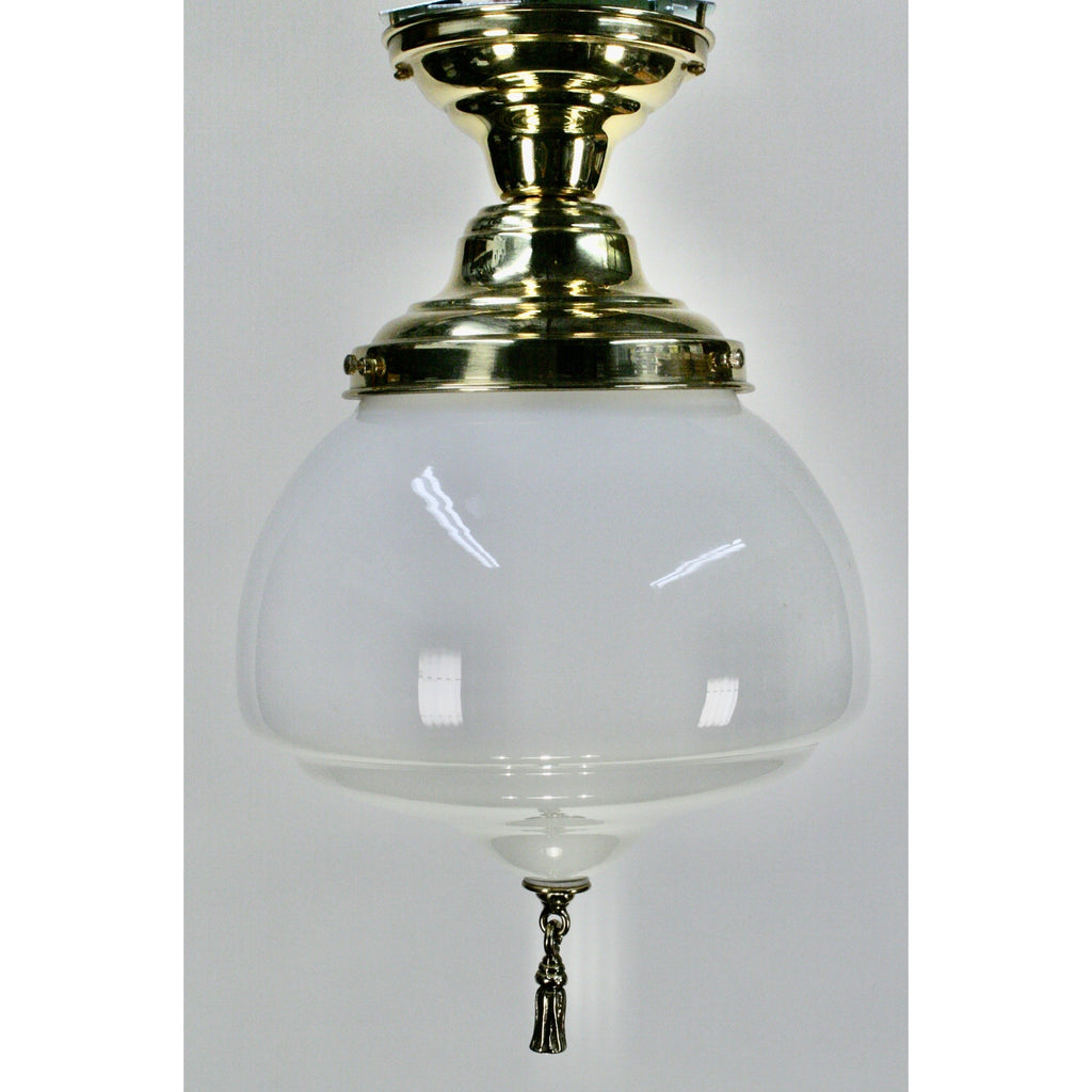 milk glass light with polished brass fixture