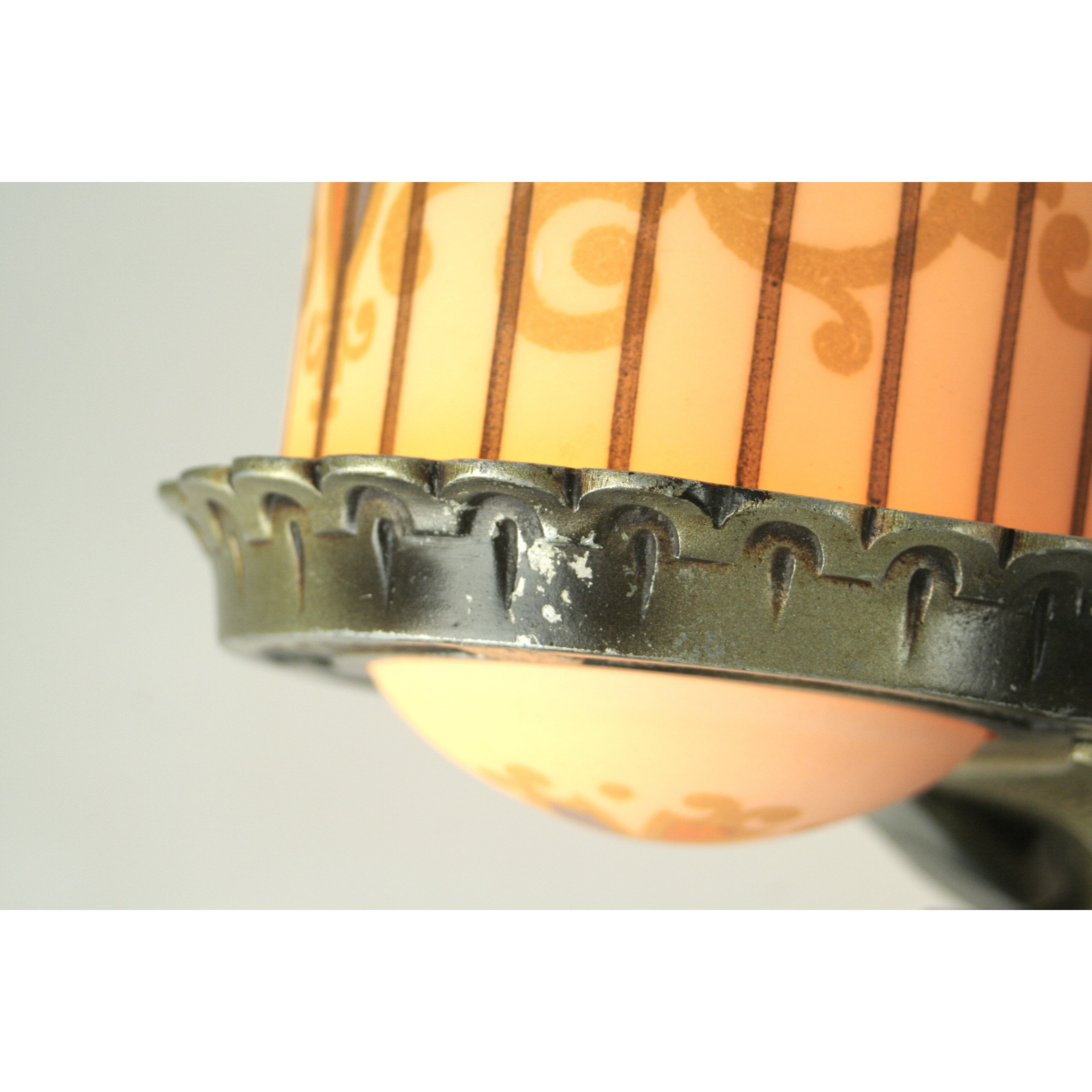 Detail of paint wear on slip shade art deco wall sconce
