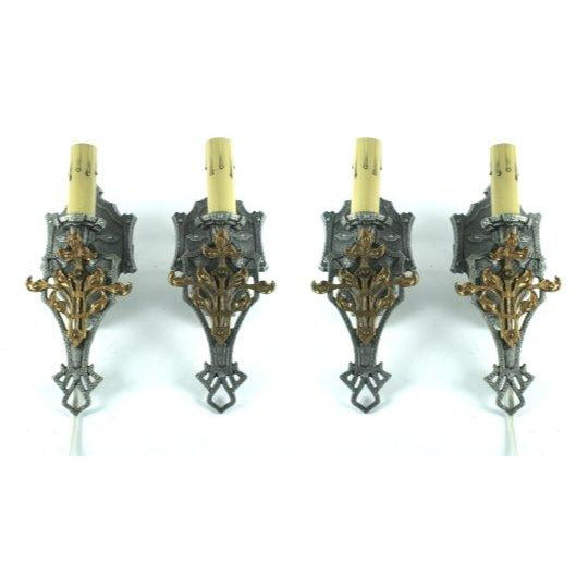 Four Spanish Revival Antique Sconces