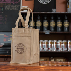 4-bottle tote bag sitting on bar
