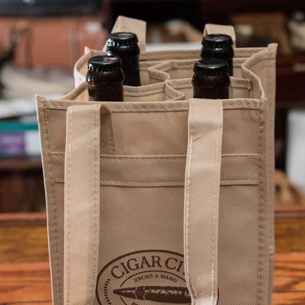 4-bottle tote bag with bottles in it sitting on bar