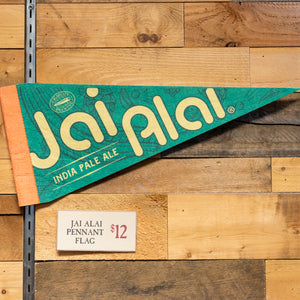 Jai Alai branded pennant flag on wall