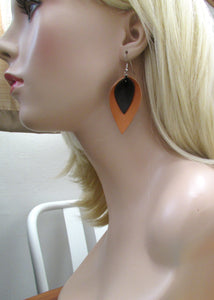 tan and black leather earrings