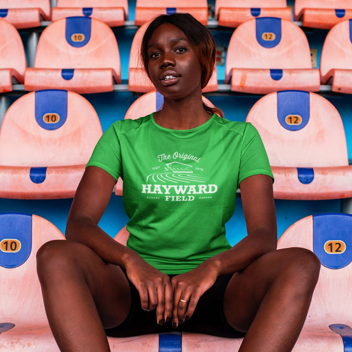 GIRL SITTING IN HAYWARD FIELD WEARING HAYWARD WOMEN'S TEE