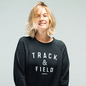 GIRL WEARING TRACK & FIELD SWEATSHIRT
