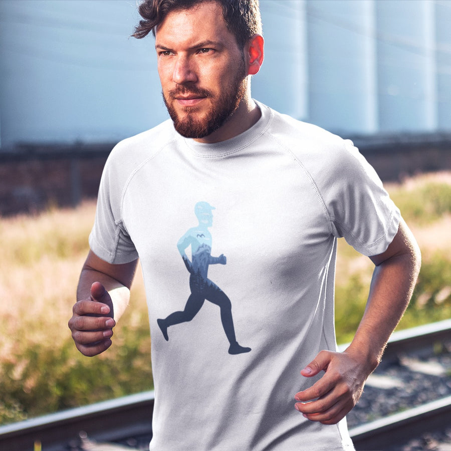 MAN RUNNING ON TRAIN TRACKS WEARING TRAIL RUNNING T-SHIRT