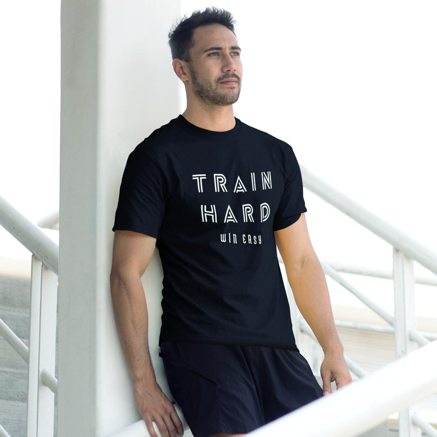 GUY AT STADIUM WEARING TRAIN HARD WIN EASY T-SHIRT
