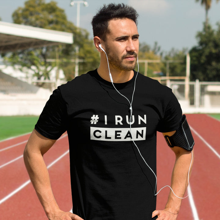 Man at track wearing I Run Clean Men's T-shirt black