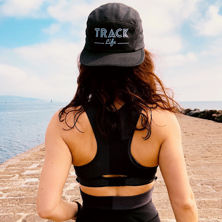 GIRL WEARING TRACK LIFE HAT