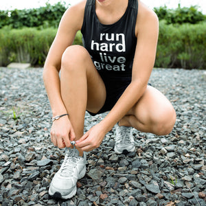 RUNNING GIRL WEARING RUN HARD LIVE GREAT TANK