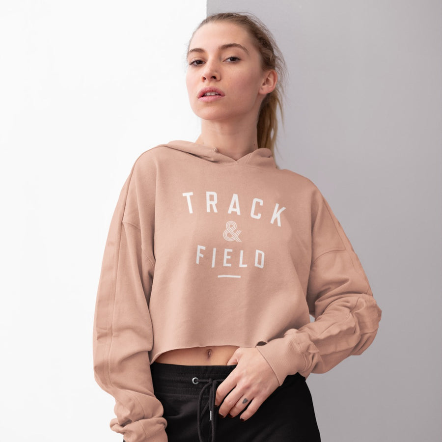 GIRL WEARING TRACK & FIELD CROP HOODIE