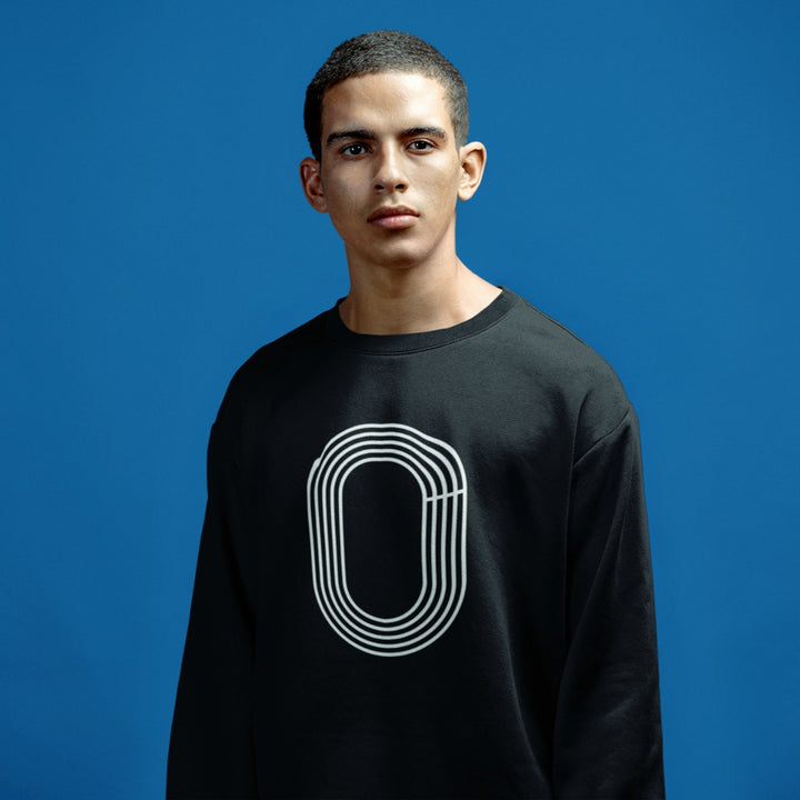 YOUNG MAN WEARING TRACK SWEATSHIRT