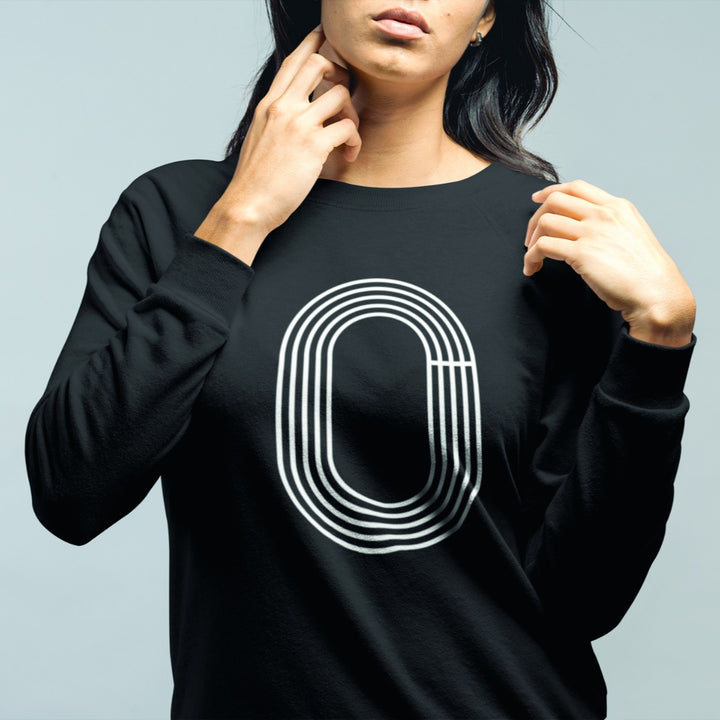 GIRL WEARING TRACK OUTLINE SWEATSHIRT
