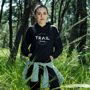 GIRL IN FOREST WEARING TRAIL RUNNING HOODIE