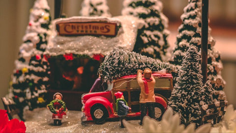 Cutting the Christmas tree at Christmas tree farm miniature scene - The Sage haven