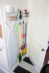 Broom and mop storage behind door - The Sage haven