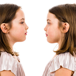 side profiles of identical twin girls