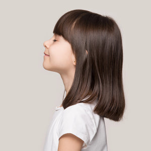 side profile of young girl with  brown hair
