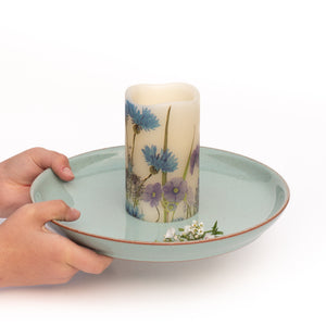 hands holding Cornflower Blue Electric Pillar Candle - the sage haven ireland