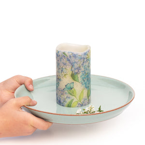 hands holding Blue Hydrangea Flameless Pillar Candles - the sage haven