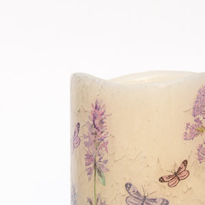 butterflies and wildflowers on led wax candle