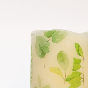 green leaf print on unscented led candle