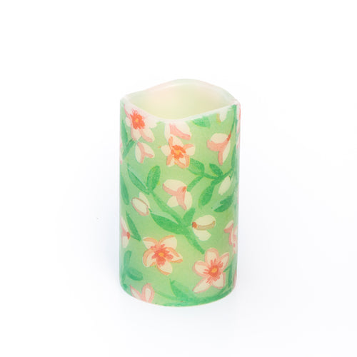 led candle with green floral design