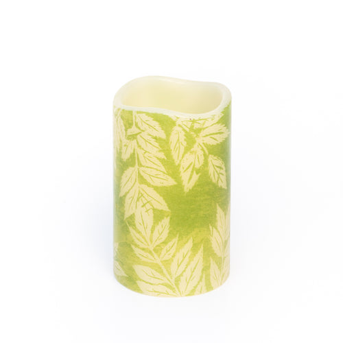 led candle with green leaf pattern