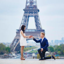 Load image into Gallery viewer, man proposing to woman in front of eiffel tower