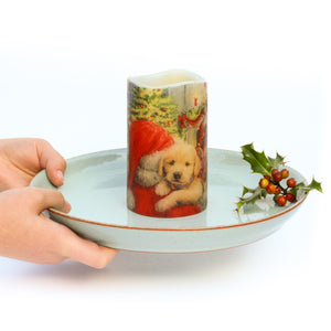 hands holding LED Christmas Candles - Santa & Puppy Decorative Candle- the sage haven, ireland