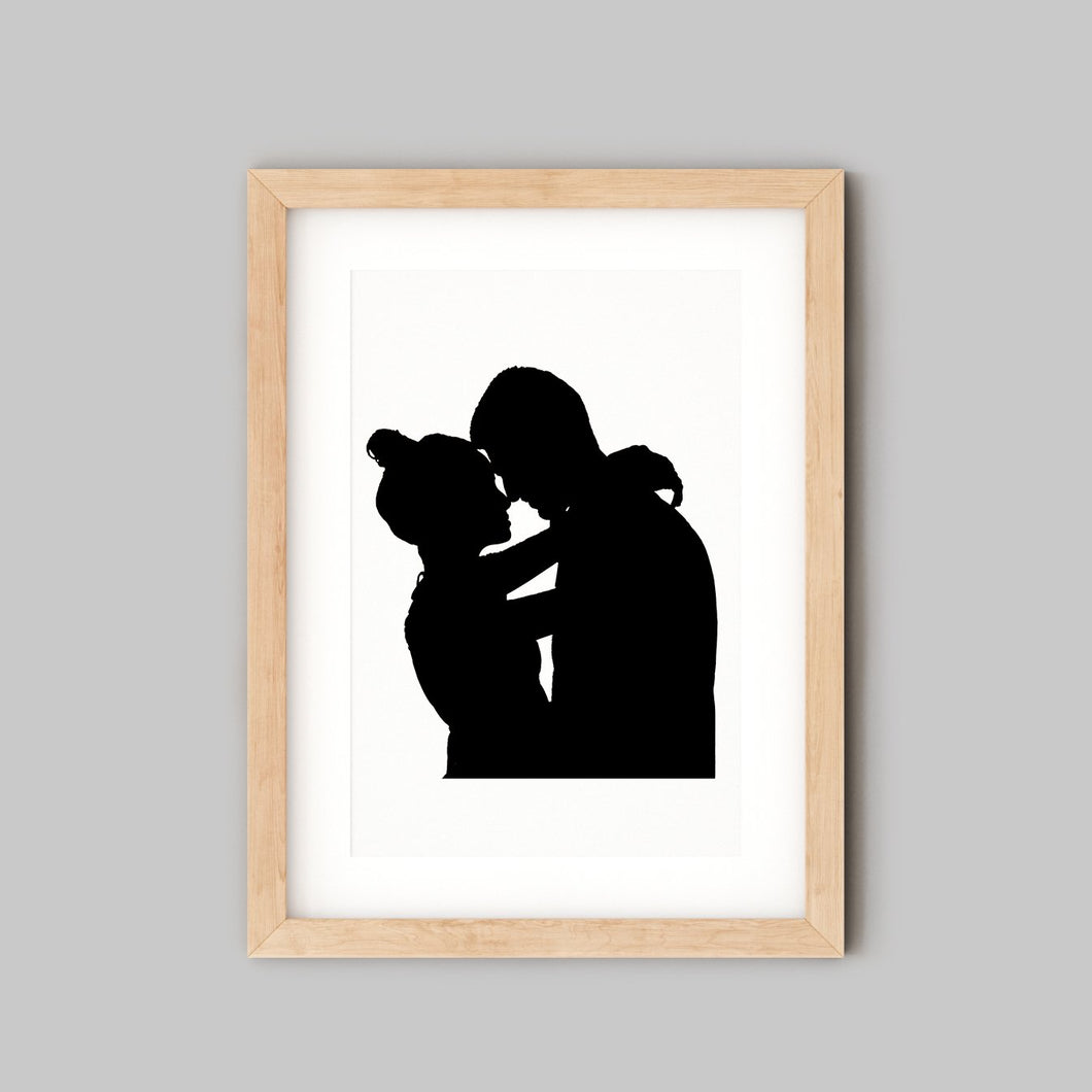 silhouette of couple embracing in wooden frame