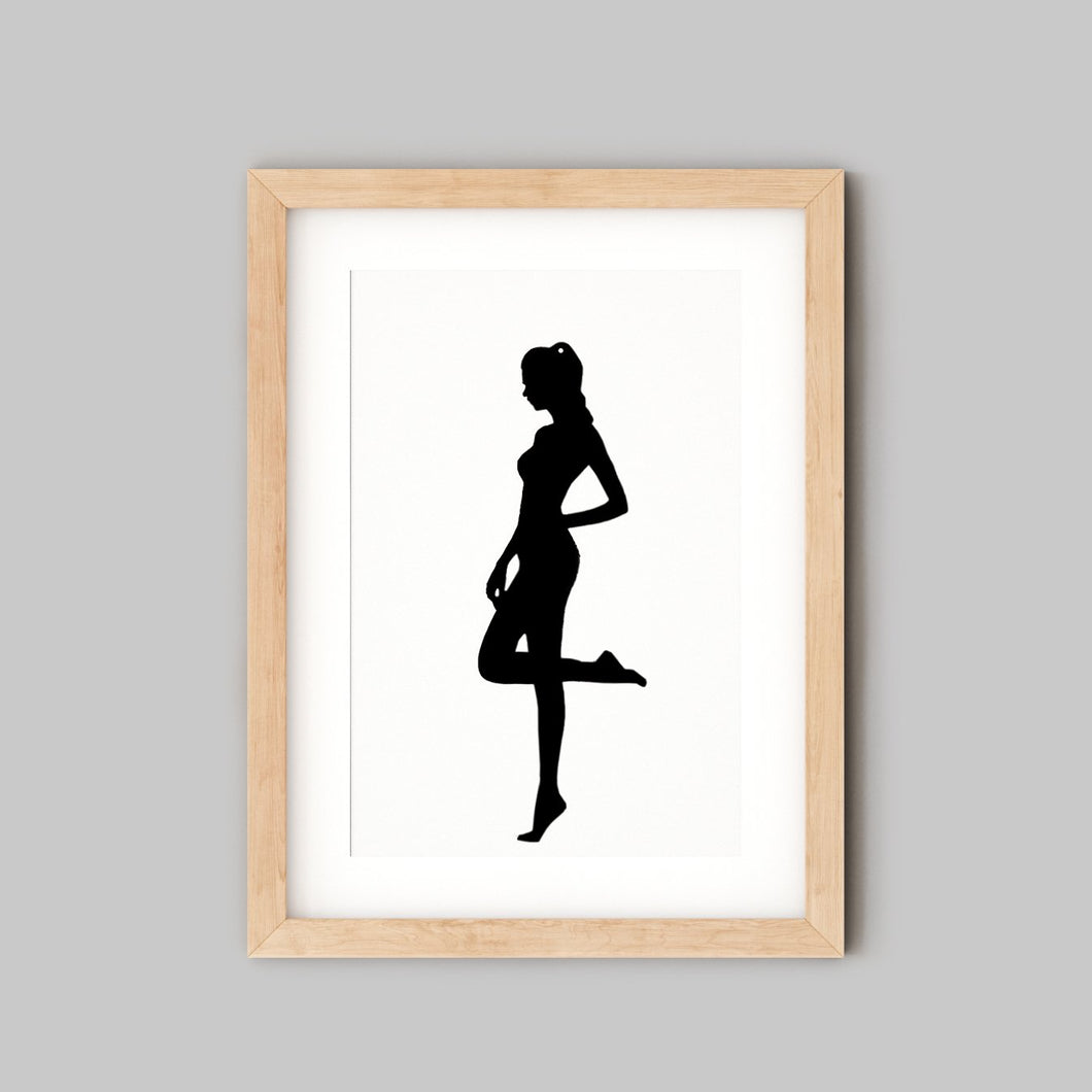 Framed silhouette portrait of woman standing