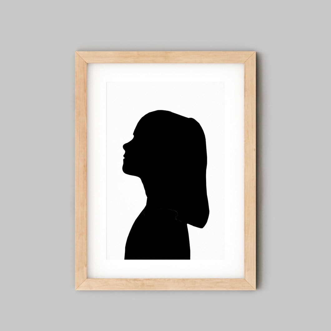 silhouette of young girl in wooden frame